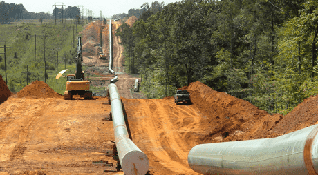 Image of a pipeline being constructed through a wooded field